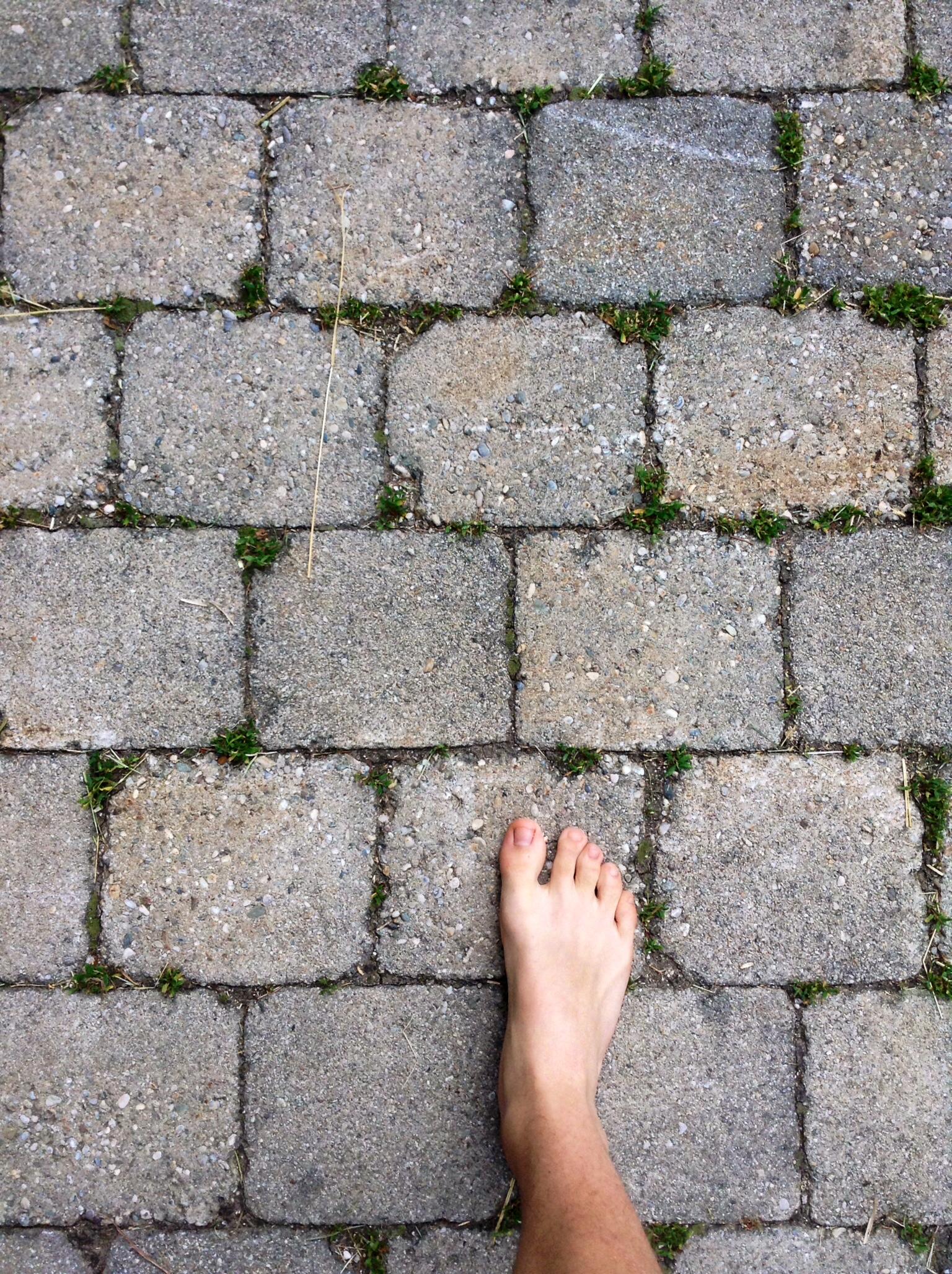 Cobblestone sidewalk w/ foot